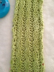 Once the pinned scarf is completely dry, it will hold it's blocked shape, revealing the mock cable stitch that's the star of the design.
