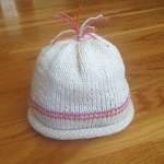 Knit baby hat, gathered top