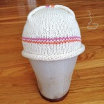 Knit baby hat, envelope closure